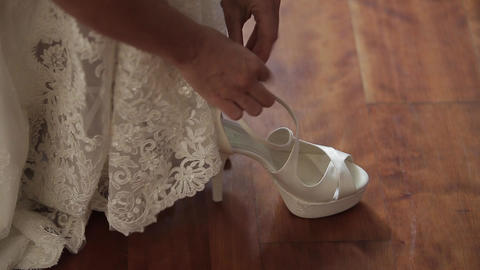 Wedding, bride's hands dress beautiful shoes Footage