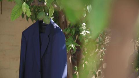 Wedding, the bridegroom's jacket is hanging in the garden Live Action