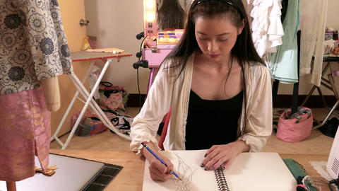 Asian American fashion designer sketching WS Footage