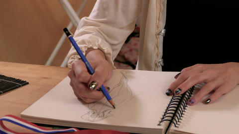 Fashion designer sketching MCU hands Footage