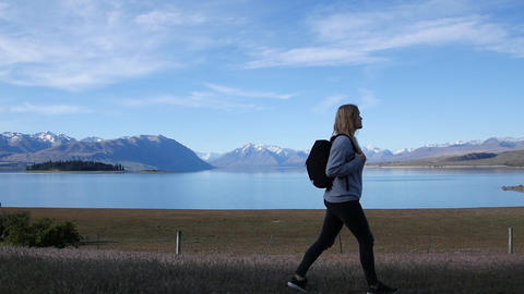 Woman Backpacks Past Beautiful Scenery Footage