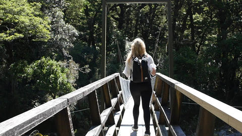 Blonde Woman Walks Across Footbridge Footage