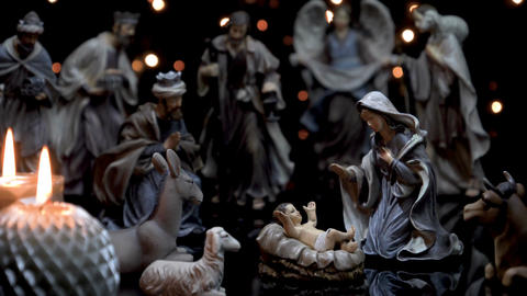 Christmas manger nativity figures scene with candles lights Footage
