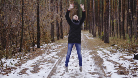 slow motion, girl jumping in the forest. synematics shot Footage