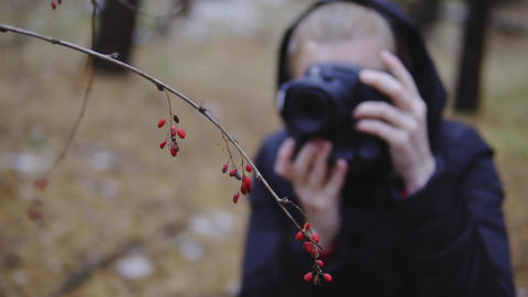 girl photographer takes pictures of the autumn forest. cinematic shot, slow Footage