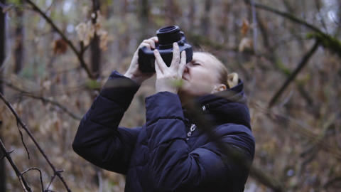 the photographer takes pictures of the autumn forest. cinematic shot, slow Footage