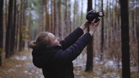 the girl takes pictures of herself in the forest on the camera. Selfi on the Footage
