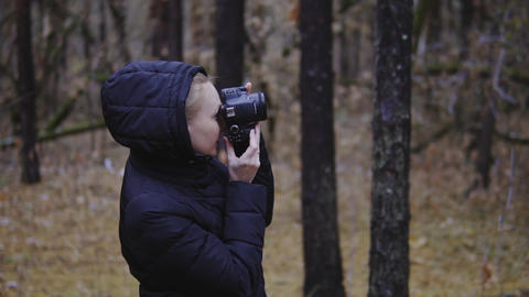 girl tourist traveler photographer takes pictures of nature. cinematic shot Footage
