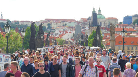 PRAGUE - CZECH REPUBLIC, AUGUST 2015: people walking crossing bridge Footage
