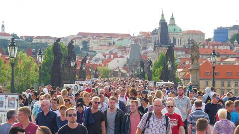 PRAGUE - CZECH REPUBLIC, AUGUST 2015: people walking crossing bridge Footage