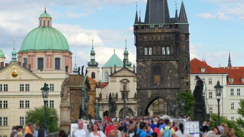 people walking crossing charles bridge, prague, czech republic, 4k Footage