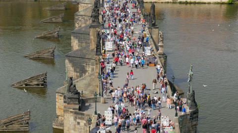 prague castle view, people walking crossing charles bridge, czech republic Footage