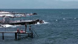 Turkey the Aegean Sea Turgutreis 041 platform for bathing in rough sea Footage