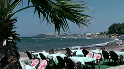 Turkey the Aegean Sea Turgutreis 068 restaurant furniture on the beach Footage
