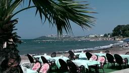 Turkey the Aegean Sea Turgutreis 068 restaurant furniture on the beach Footage