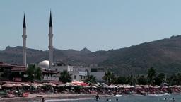 Turkey the Aegean Sea Turgutreis 070 local beach and big mosque Footage