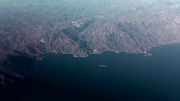 Turkey the Aegean Sea Turgutreis 104 Aegean coast through tinted aircraft window Footage