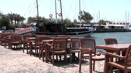 Turkey the Aegean Sea Turgutreis 014 harbor restaurant in bright midday sun Footage