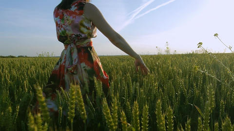 girl in a field smiling emotions hands dancing ears laughs runs listening to Footage