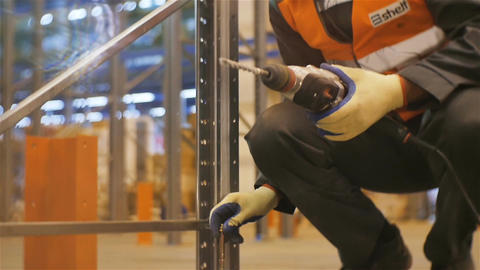 Slow Motion Worker Puts Metal Fastening in Construction Footage