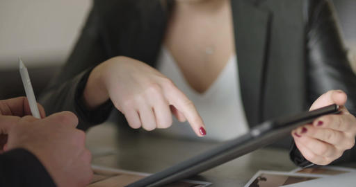 Extreme close up of business woman's hands using tablet computer Footage