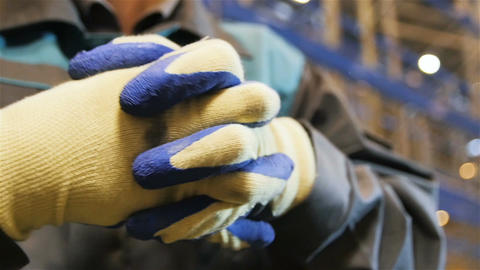 Slow Motion Closeup Person in Blue-white Working Gloves Live Action