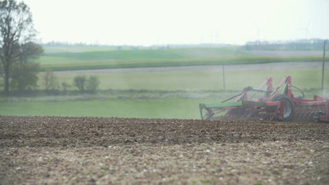 Cultivating background. Harvesting field. Agricultural tractor plowing field Live Action