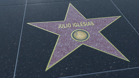 Hollywood Walk of Fame star with JULIO IGLESIAS inscription. Editorial clip Footage