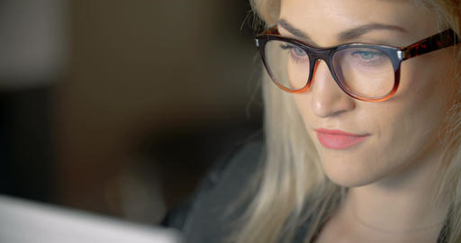 Businesswoman Wearing Eyeglasses While Using Laptop In Office Footage