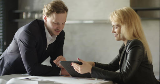 Businesswoman and Businessmam having successful conversation in meeting room Footage