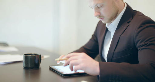 Business - Attractive business man using digital tablet Footage