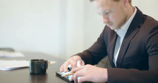 Business - Attractive business man using digital tablet Stock Video Footage