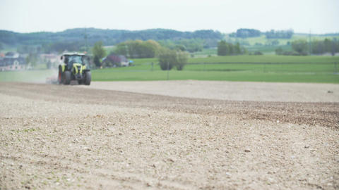 AGRICULTURE - Wide shoot of Agricultural tractor sowing and cultivating field ビデオ