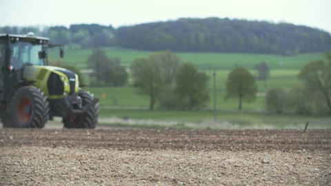 AGRICULTURE - Agricultural tractor sowing and cultivating field Footage