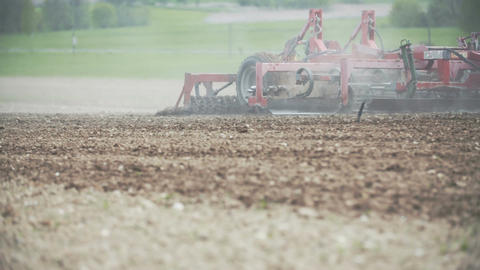 Agricultural tractor cultivating field Footage