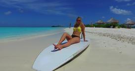 v11995 one 1 beautiful young girl in bikini sunbathing on surfboard paddleboard Footage