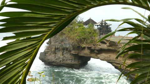 Pura Penataran Luhur temple behind palmtree, Bali, Indonesia Footage