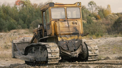 Crawler Tractor on Glass Production and Construction Mixture Footage