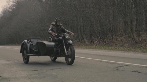 Man Driving on a Retro Motorcycle Footage