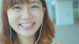 woman smile happily and use phone listen music Footage