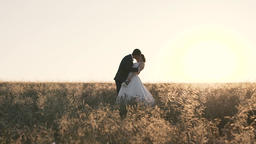 Romantic Couple Walks in Sunset Footage