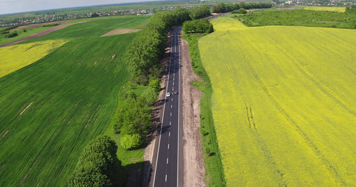 Flying Over the Road Trafic in a Field Footage