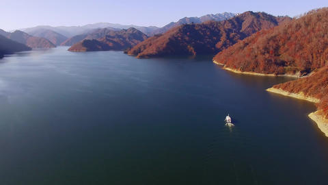 Aerial - Late autumn lakes and sightseeing boat and autumn mountains Footage