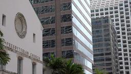 USA Florida Miami First Miami Presbyterian Church with modern skyscrapers ビデオ
