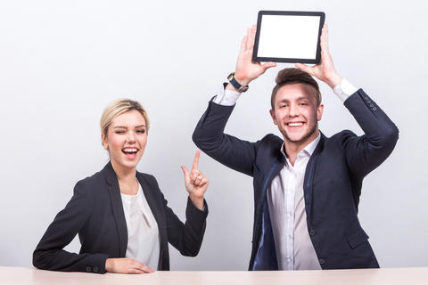 Picture of couple of office workers both holding tablet Photo