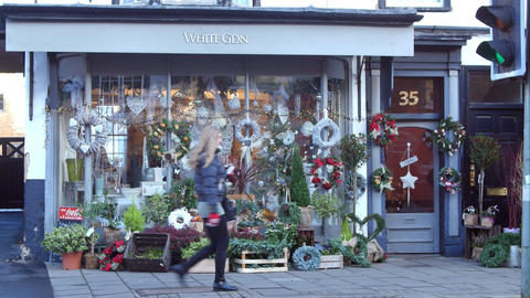 Exterior Of Florists Shop With Traffic And Pedestrians Footage