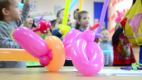 Kindergarten children receive colored balloons that they will fight among themse Footage