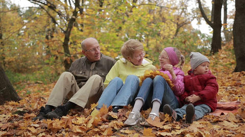 Happy family spending leisure in autumn park Live Action
