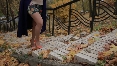 Woman's legs in high heels stepping up the stairs Footage