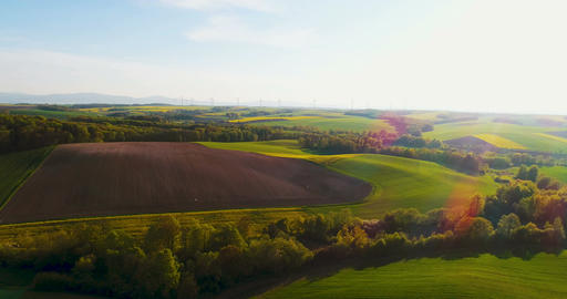 Beautiful agricultural landscape against ecological windmills farm Footage
